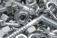 Close-up of metal bolts, nuts and chain. Technology background Royalty Free Stock Photography