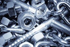 Close-up of metal bolts, nuts and chain. Technology background. Close-up of metal bolts, nuts and chain.  Technology background Royalty Free Stock Photography