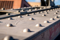Close up on a metal bridge. On a sunny day Royalty Free Stock Image