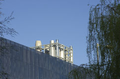 Close up metal chimneys on the factory roof. Royalty Free Stock Photo