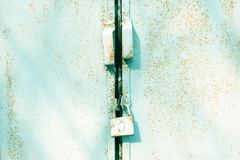 Close up metal door with lock, grungy style. Industrial blue background. Close up of metal door with lock, grungy style. Industrial blue background Stock Photography