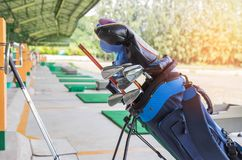 Close up metal golf clubs in bag at golf course Royalty Free Stock Image