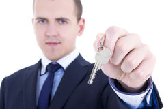 Close up of metal key in male real estate agent hand isolated on stock photography