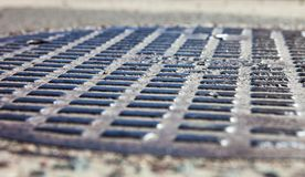 Close up of the metal manhole cover Royalty Free Stock Photos