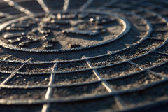 Close-up of the metal manhole cover Stock Photos