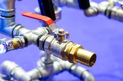 Close up of metal pipelines with ball valve stock photography