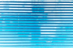 Close up of metal roller shutter door, Blue metal plate wall texture and background, Close up image Stock Photos