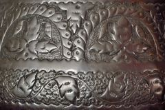Close up of a metal sculpted plate Stock Images