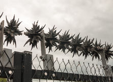 Close up of metal spikes on fence protecting power grid stock photo