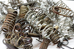 Close up of metal various springs and coils on white background royalty free stock image