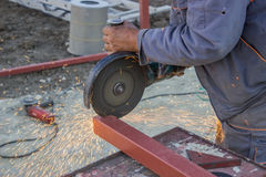 Close up of metal worker using angle grinder to grinding metalba Stock Photo