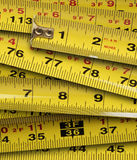 Close up of metal yellow measuring tapes Stock Images