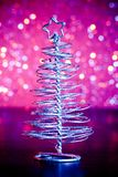 Close-up of metallic modern christmas tree on wood table Royalty Free Stock Images