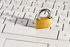Close-up of a metallic padlock on a keyboard Royalty Free Stock Photography