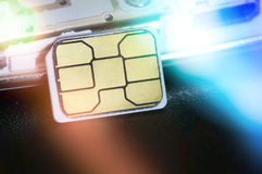 Close-up of micro sim card. Image with blue flare Royalty Free Stock Photos