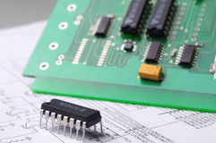 Close-up on a microchip. On a scheme background royalty free stock photo