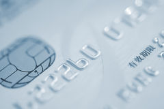 Close up on the microchip of a Chinese credit card in blue tone Royalty Free Stock Photo