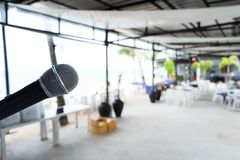 Close up Microphone on abstract blurred background of speech seminar, meeting, event in outdoor restaurant. stock photos