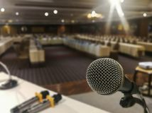 Close up of microphone on abstract blurred of speech in seminar room or speaking conference hall light background stock images