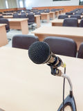 Close up Microphone on background lecture hall Stock Image