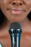 Close up of microphone being used by singer Stock Photo