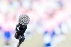 Close up of microphone with blurred background. In concert hall or conference, seminar room stock images