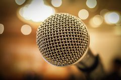Close up of microphone in concert hall or conference room with l Royalty Free Stock Photo