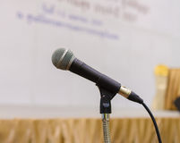 Close up of microphone in conference hall Stock Image