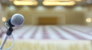 Close up. Microphone in conference hall. Business meeting. Microphone Training. Audience at the conference hall. Background blur. Business Conference with royalty free stock photography