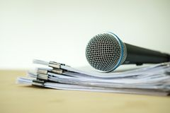 Close up a Microphone with paper document , concept of speaker o Royalty Free Stock Photography
