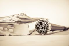 Close up a Microphone with paper document , concept of speaker o. Close up Microphone with paper document , concept of speaker or teacher preparation to speak in stock photography