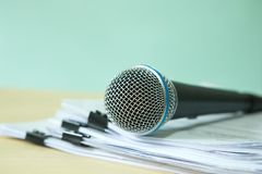 Close up a Microphone with paper document , concept of speaker o. Close up Microphone with paper document , concept of speaker or teacher preparation to speak in royalty free stock photos