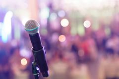 Close up microphone on stage in concert hall restaurant or conference room. Blurred background. Copy space. Close up microphone on stage in concert hall Royalty Free Stock Photo