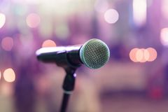 Close up microphone on stage in concert hall restaurant or conference room. Blurred background. Copy space. Close up microphone on stage in concert hall Stock Photo