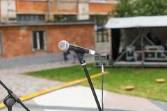 Close up of microphone on a stage Stock Images