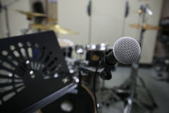 Close up of microphone with vintage picture style. Music equipment in training room Royalty Free Stock Photo