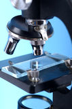 Close-up of a microscope. And speciman Royalty Free Stock Image