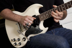 Close-up of mid adult man's torso playing guitar Royalty Free Stock Photo