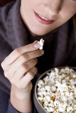 Close-up of a mid adult woman eating popcorn Royalty Free Stock Image
