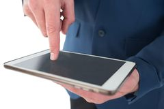 Close up mid sectiong of businessman using tablet pc Royalty Free Stock Photos
