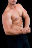 Close-up mid section of a shirtless muscular man Stock Photos