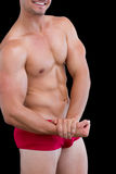 Close-up mid section of a shirtless muscular man Stock Photography