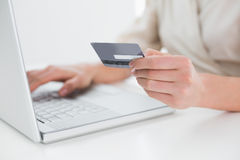 Close up mid section of woman doing online shopping Royalty Free Stock Photos