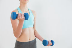 Close up mid section of woman with dumbbells Stock Photography