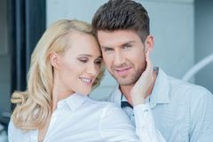 Close up Middle Age Sweet Couple on White Attire Stock Photo