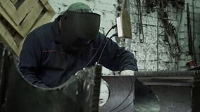 Middle-aged Man A Blacksmith In Protective Clothing Connects The Two Sides