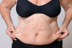 Close up Middle Aged Woman Holding her Fatty Belly Royalty Free Stock Photos
