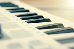 Close up of MIDI controller volume fader, knob and keys. Close up MIDI controller volume fader, knob and keys Stock Images