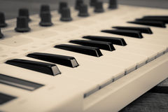 Close up of MIDI controller volume fader, knob and keys. Royalty Free Stock Photo