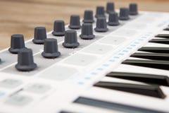 Close up of MIDI controller volume fader, knob and keys. Close up  MIDI controller volume fader, knob and keys Stock Image